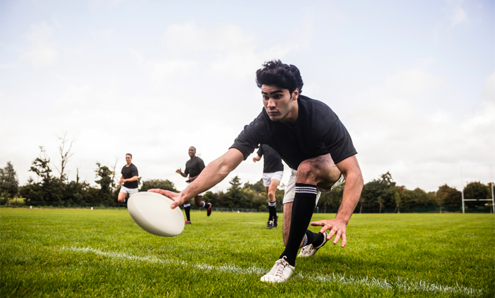 sports professionals playing rugby
