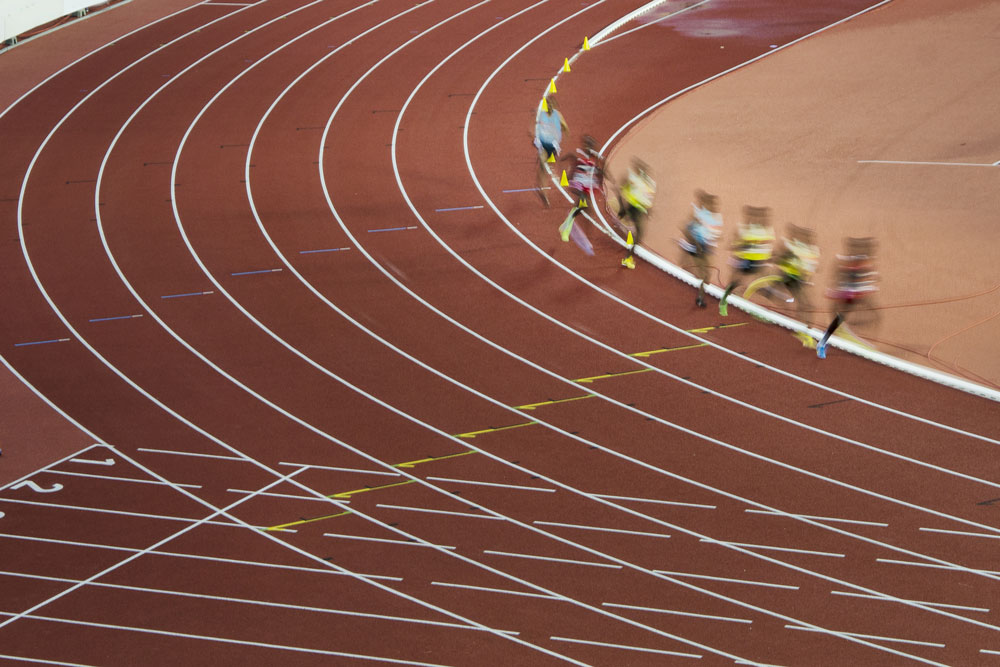 Athletes in motion on professional track and field race