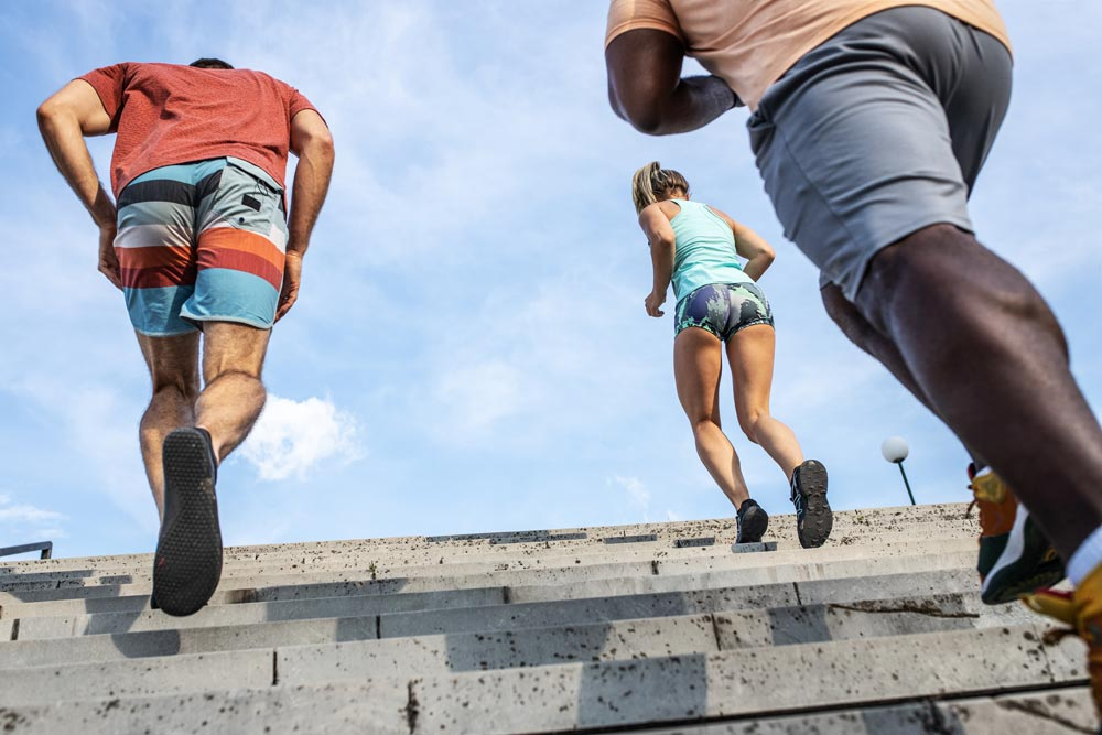 athletes running up the stairs, pushing to the limit
